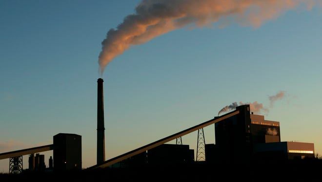 A coal-fired power plant churns out electricity in Holcomb, Kan., in 2007. A report finds a 95% certainty that global warming is being caused by humanity.