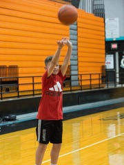 Michael Meraz, 11, shoots a basketball durin ghe Camp of Champs Basketball Camp at Oñate High School, Tuesday July 24, 2018.