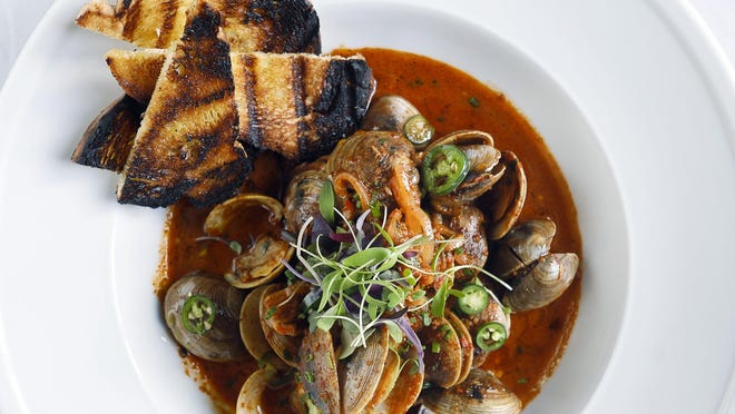 Harissa Clams prepared at the newly opened Lola 41 restaurant in Palm Beach.