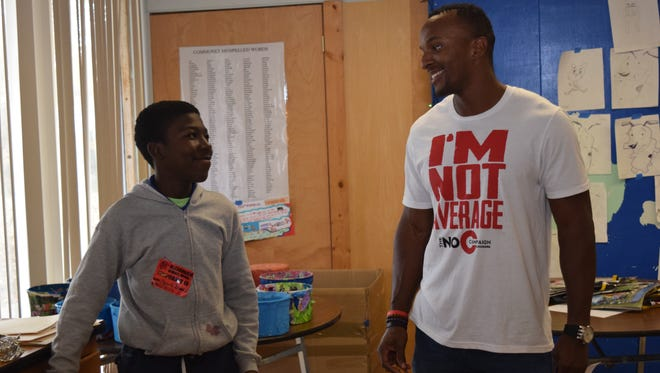 """Bryan Sampson (right), of the """"No C Campaign,"""" talks with Alexandria Middle Magnet School student Edward James."""