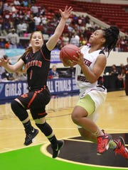 Madison County (1) Tamiera Mobley flies past Trenton (1) Bryn Thomas during the FHSAA 1A Girls State Championship Basketball Game at the Lakeland Center in Lakeland, Florida February 17, 2016. The Ledger/Pierre DuCharme