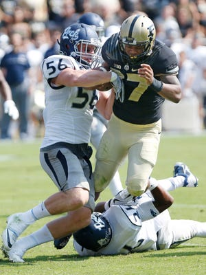 Nevada's Alex Bertrando strips the ball from Brian Lankford-Johnson with 28 seconds remaining in the third quarter against Nevada Saturday, September 24, 2016, at  Ross-Ade Stadium. Nevada recovered Lanford-Johnon's fumble. Purdue defeated Nevada 24-14.