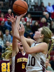 Shippensburg's Liz Logan (10) drives to the hoop for