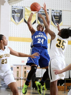 Sayreville's Isi Enahoro puts up a shot between Piscataway's Laniya Miller (left) and Wande Adeyemo in a GMC Tournament semifinal game on Feb. 23, 2015.