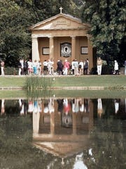 Visitors walk past the monument to Princess Diana on the lake at her family home of Althorp, in Northamptonshire, in  1998.