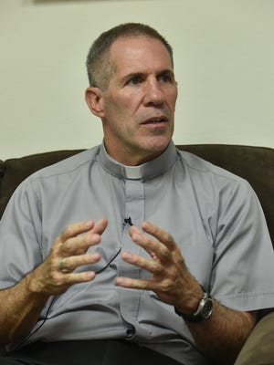 Archbishop Michael Jude Byrnes speaks during an interview at the Archidiocese of Agana Chancery Office on Oct. 27, 2017.