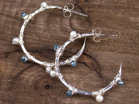 Earrings by Michelle Pressler, whose jewelry is featured