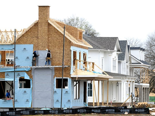 Workers build new homes in Westhaven subdivision in