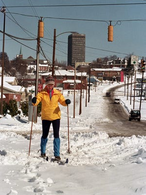 After getting a ride part of the way, nurse Pegi O'Hagan skis to her job at Mission Hospital along an only partially cleared Biltmore Avenue two days after a blizzard dumped 16-18 inches of snow on Asheville and left thousands homebound and without electricity in 1993.