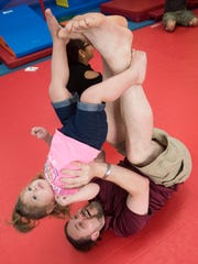 Craig Duvall and his daughter, Coraline workout at