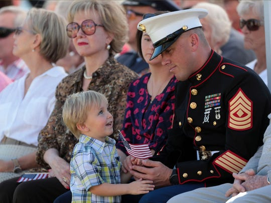 US Marine Iraq War veteran David Tellefsen, from 29 Palms, keeps an eye on his 3 year old son Troy during the   Rancho Mirage's Veterans Day celebration on Saturday, November 11, 2017 at Rancho Mirage Community Park.