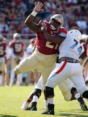 Florida State Seminoles defensive tackle Marvin Wilson (21) applies defensive pressure during the fourth quarter of play Delaware State Hornets and the Florida State Seminoles at Doak Campbell Stadium. Florida State won 77-6.