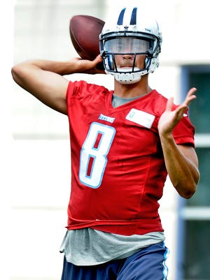 Titan Marcus Mariota passes during organized team activity with veterans and rookies at St. Thomas Sports Park on Wednesday, May 27, 2015, in Nashville.