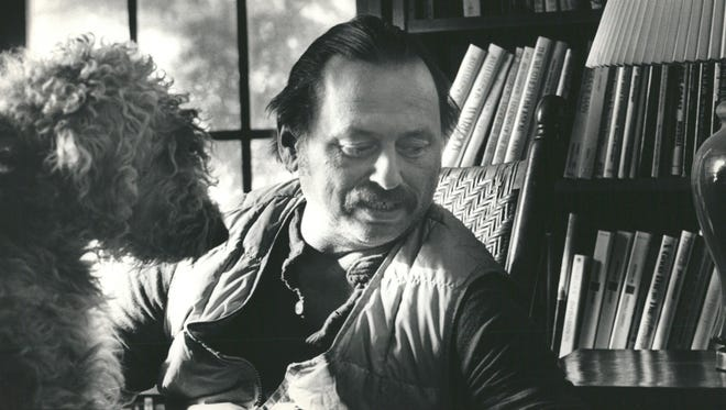 Jim Harrison relaxes in his northern Michigan home.