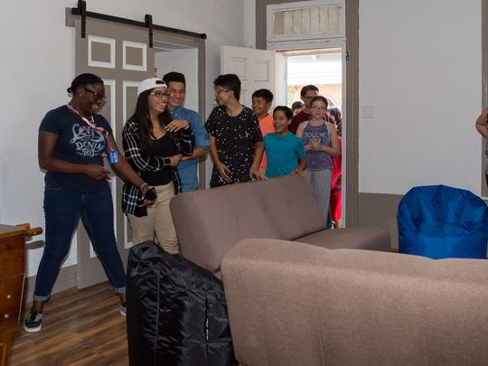 Las Cruces Boys & Girls Club teen members react with joy when they see the renovated rooms designated for teens at the club on Monday, July 10, 2017.
