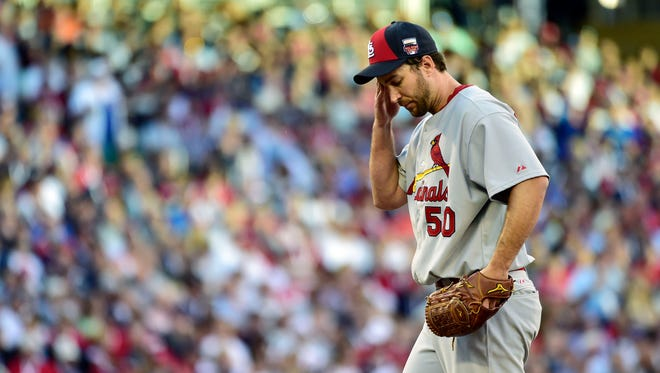 National League pitcher Adam Wainwright (50) of the St. Louis Cardinals reacts after giving up a two-run home to American League infielder Miguel Cabrera (not pictured) of the Detroit Tigers in the first inning during the 2014 MLB All Star Game at Target Field.