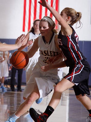 Haslett's MacKenzie DeCook, left, shown during a game earlier this season, was one of Tuesday's top performers.