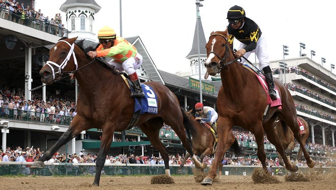 Dame Dorothy, left, with Javier Castellano aboard, holds off Judy the Beauty, with Mike Smith aboard, right, to win the Humana Distaff.May 1, 2015