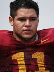 Iowa State defensive end Gabe Luna takes a breather on the sidelines during the Iowa State football spring scrimmage on Saturday, April 12, 2014, at Jack Trice Stadium in Ames, Iowa.