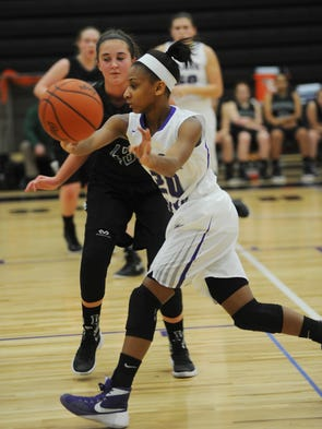 Bloomfield's Imanni Wright (right) executes a no-look