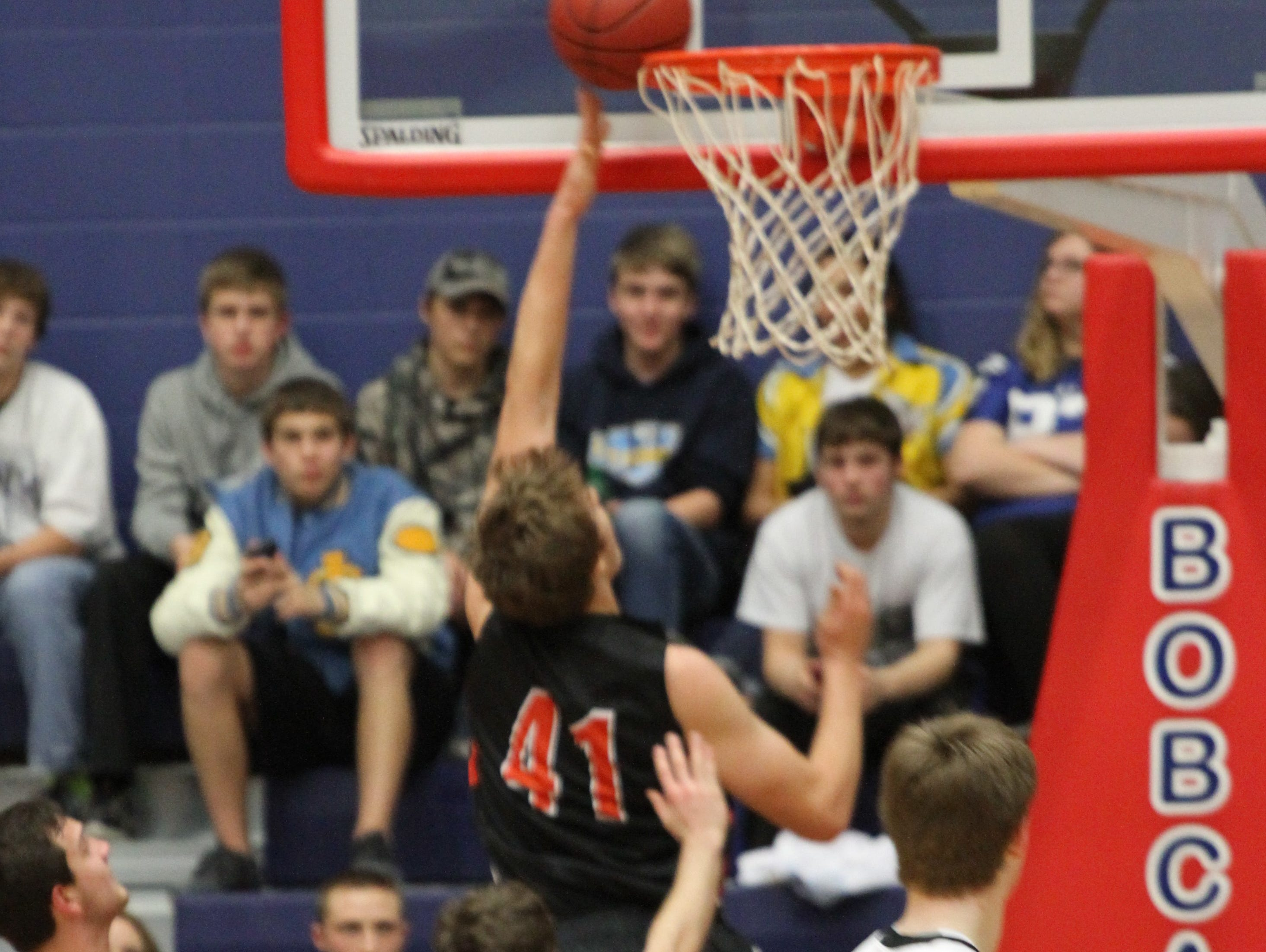 Grinnell's Cade McKnight, 41, hits two points during the Class 3A District 12 final won by Newton 62-49 at Marshalltown on Thursday, Feb. 25, 2016.
