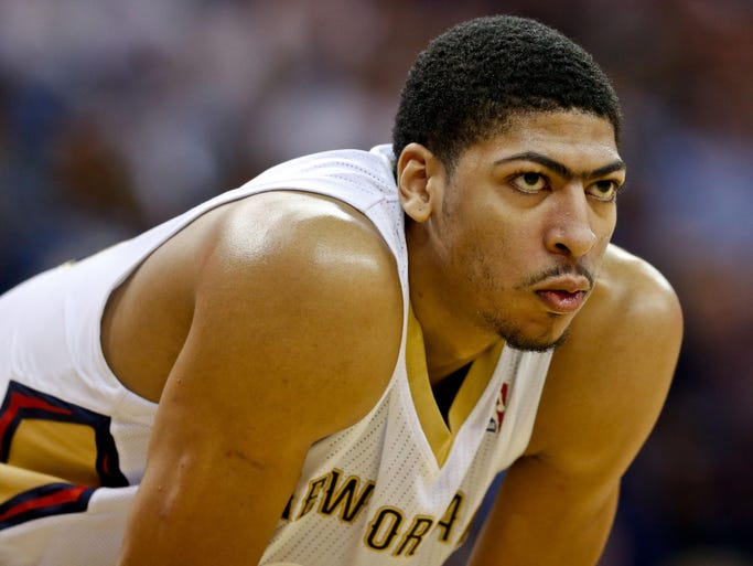 Pelicans forward Anthony Davis, along with his infamous unibrow, has emerged as one of the brightest young players in the NBA. Flip through this gallery to see how he got here.