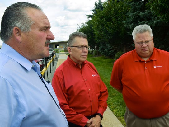 Manitowoc Crane executives Barry Pennypacker, left,