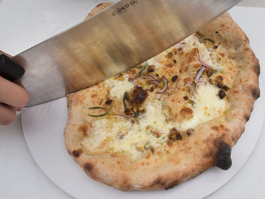 Pistachio pizza by Forno Bova. White pizza with pistachios,