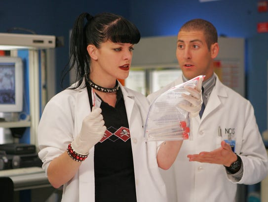 "When Tony (Michael Bellisario) is accused of murder, Abby (Pauley Perrette) questions her faith in her science in the 2005 ""Frame-Up"" episode of 'NCIS.' (Photo: Cliff Lipson/CBS)"