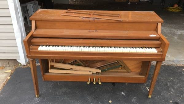 One of many free pianos offered on Rochester's Craigslist page.