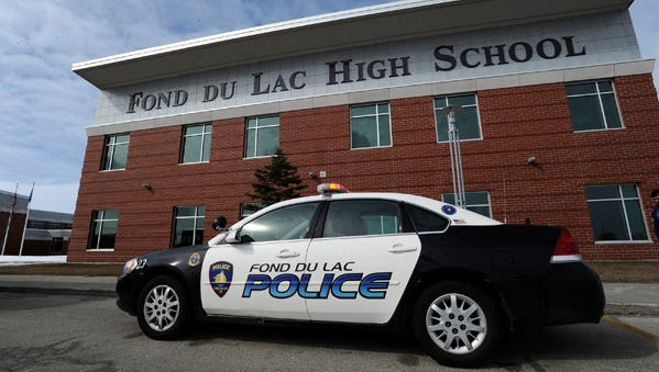 Fond du Lac police officers respond to Fond du Lac High School on March 26, 2013.