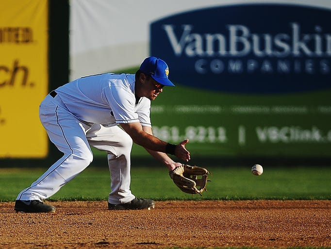 Canaries' second baseman Shelby Ford fields a ball before a throw to first base for an out during a game against the Fargo-Moorhead Redhawks on Friday, June 13, 2014, at the Birdcage in Sioux Falls.