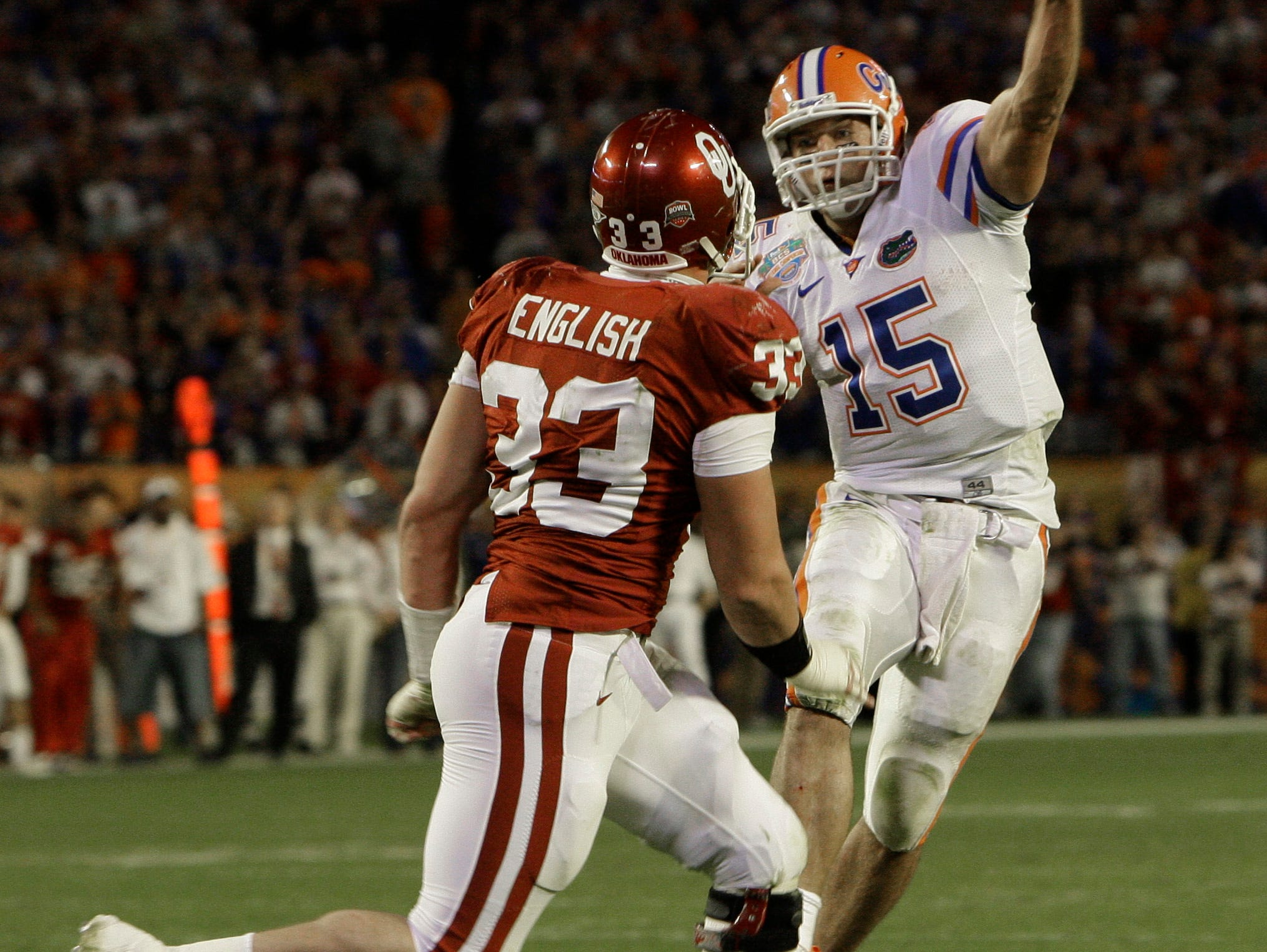 Florida's Tim Tebow (15) throws a pass over Oklahoma's Auston English (33) during the third quarter of the BCS Championship NCAA college football game in Miami, Thursday, Jan. 8, 2009. (AP Photo/Mark Humphrey)