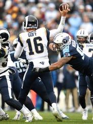 Titans linebacker Derrick Morgan (91) presses Rams quarterback Jared Goff (16) during the second half Sunday.