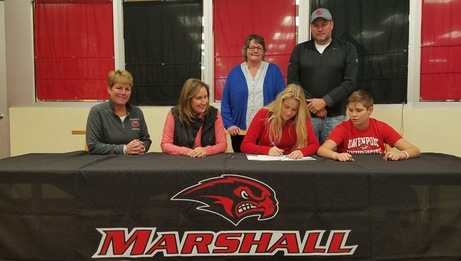 Marshall High school senior Natalie Tucker signs to play basketball at Davenport University. She is joined by (L-R) head coach Sal Konkle,  Jackie Tucker, Carol Tucker, Natalie Tucker, Brent Tucker and Nathan Tucker.