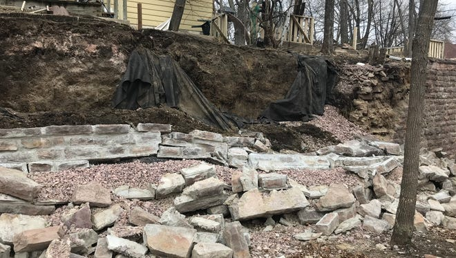 Neighbors had complained to the city about repairs being done to a wall at 300 N. Duluth Ave. The wall collapsed last week.