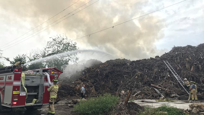 The San Carlos Fire Department is responding to a mulch fire at MW Horticulture in south Fort Myers.