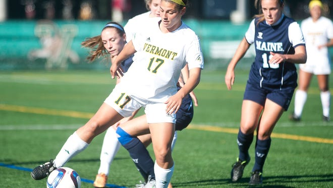 Vermont forward Nikki McFarland controls the ball ahead of a Maine defender during Thursday's women's soccer game at Virtue Field.