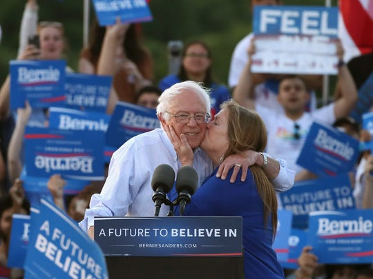 WASHINGTON, DC -- Sen. Bernie Sanders (I-VT), gets a kiss from his wife Jane O'Meara Sanders after speaking at a campaign rally at Robert F. Kennedy Memorial Stadium June 9, 2016 in Washington, DC. After a meeting with President Barack Obama earlier at the White House, Sanders said he will work with Hillary Clinton to beat Donald Trump in the presidential election.
