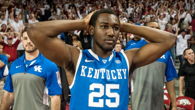 Jan 14, 2014; Fayetteville, AR, USA; Kentucky Wildcats guard Dominique Hawkins (25) reacts during a break in play against the Arkansas Razorbacks at Bud Walton Arena. Arkansas defeated Kentucky 87-85 in overtime. Mandatory Credit: Beth Hall-USA TODAY Sports