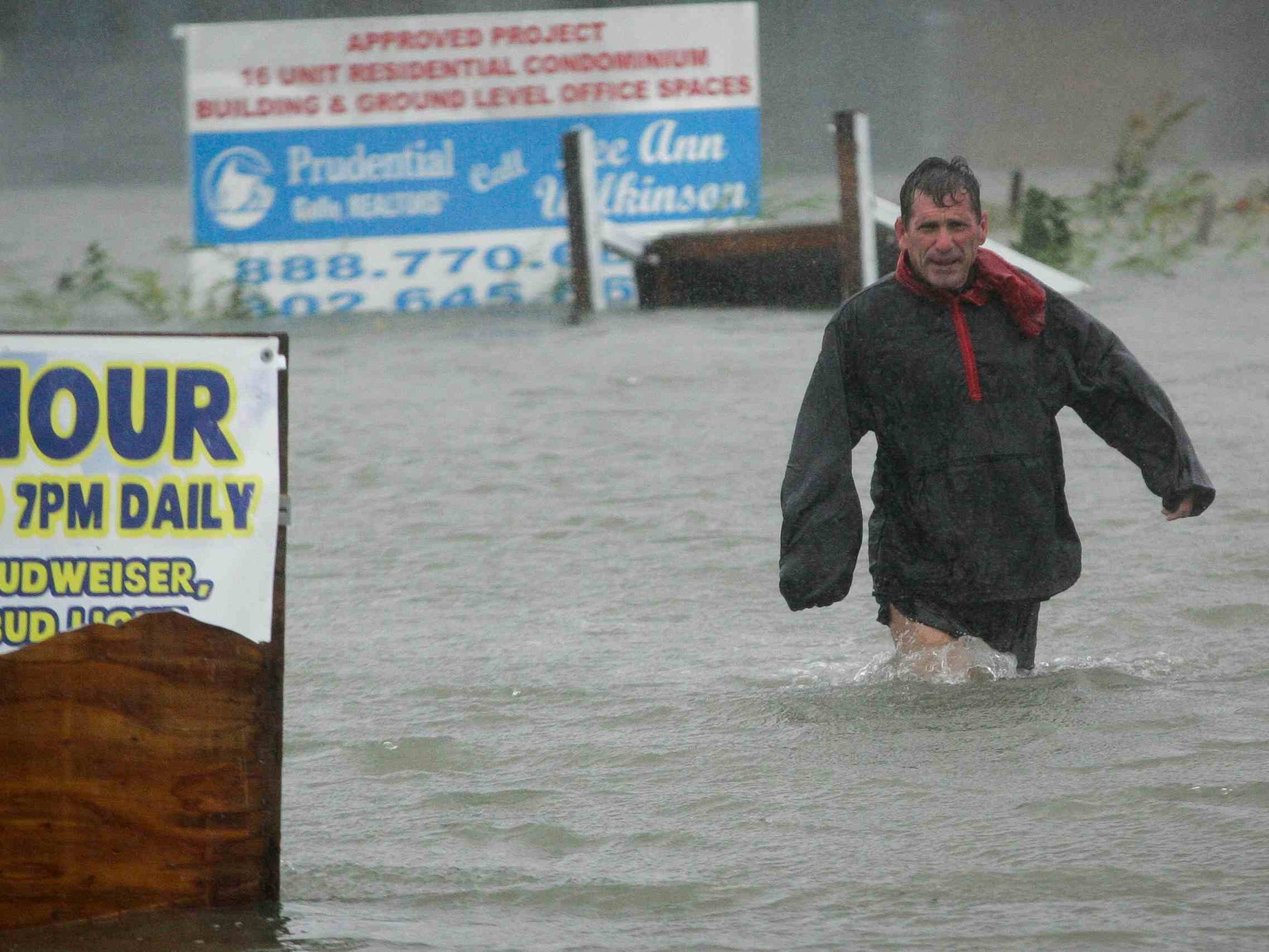 Bob Casseday crosses a flooded street in Lewes on his way home after checking his boat line on Monday. SUCHAT PEDERSON/THE NEWS JOURNAL 10/29/12 - Lewes, Del. - DE SANDY2012 102912 - After checking to make sure his boat line is secure, Bob Casseday crosses the waist high flooded street just over the bridge along Savannah Road in Lewes to get back home as Superstorm Sandy hits Delaware Monday, Oct. 29, 2012.     SUCHAT PEDERSON/THE NEWS JOURNAL