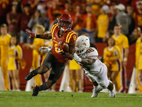 Iowa State receiver Deshaunte Jones gains yards after pulling in a catch against Texas on Thursday, Sept. 28, 2017, at Jack Trice Stadium in Ames.