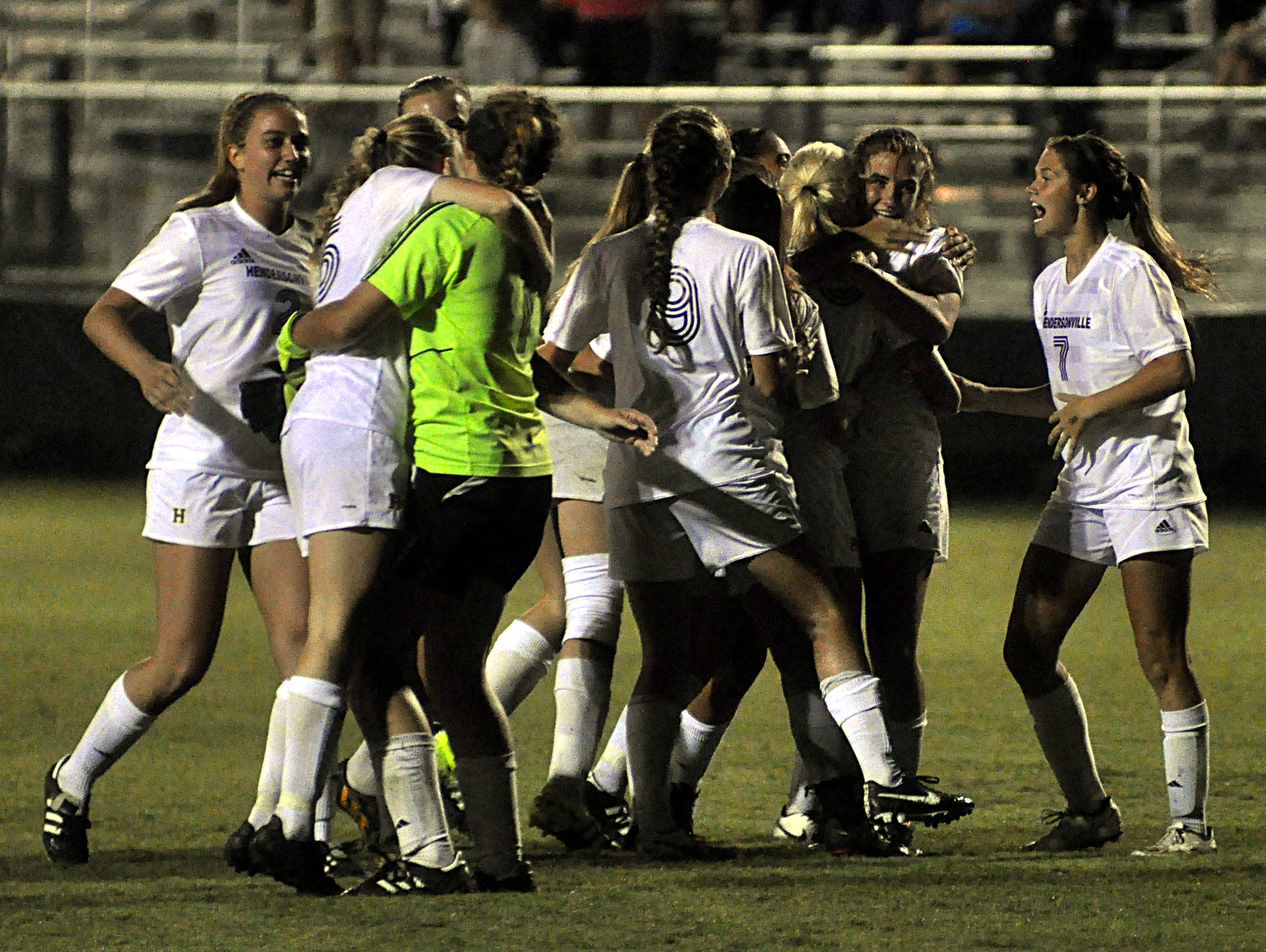 Hendersonville High players celebrate after their 2-1 victory over Station Camp on Tuesday.