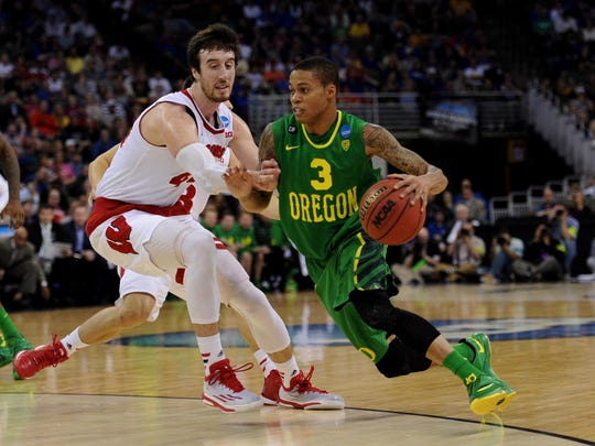 Mar 22, 2015; Omaha, NE, USA; Oregon Ducks guard Joseph Young (3) dribbles around Wisconsin Badgers forward Frank Kaminsky (44) during the first half in the third round of the 2015 NCAA Tournament at CenturyLink Center. Mandatory Credit: Steven Branscombe-USA TODAY Sports