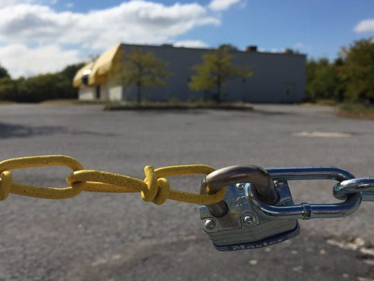 A padlock and chains are shown at the parking lot of