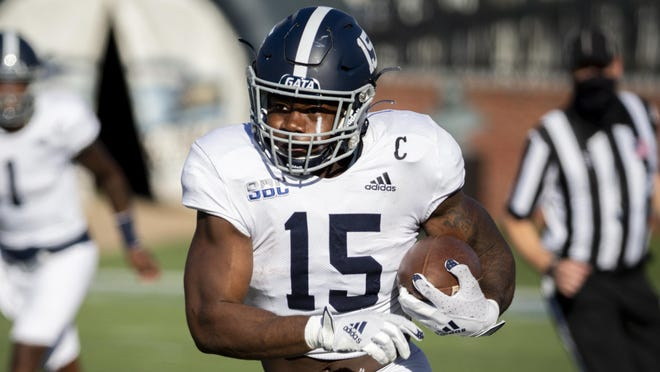 Georgia Southern running back J.D. King (15) runs the ball against Massachusetts on  Oct. 17 in Statesboro.