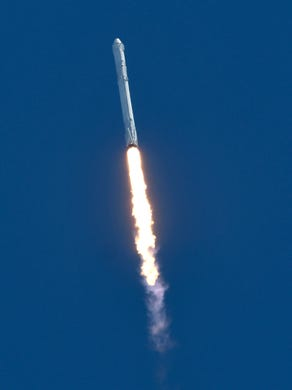 AS paceX Falcon 9 rocket rocket takes off from the pad