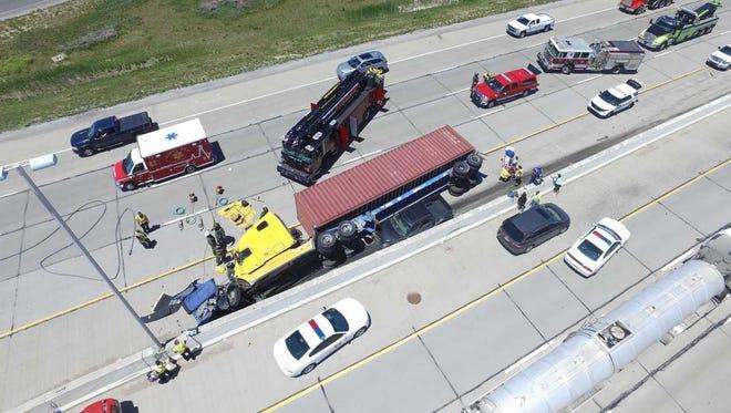 Five people were hospitalized following a semi versus pickup truck collision on I-465 near Sam Jones Expressway on June 4, 2018.