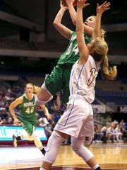 Wall's Macy Gully goes up for a shot as a Brock Lady Eagle tries to block her on Saturday.