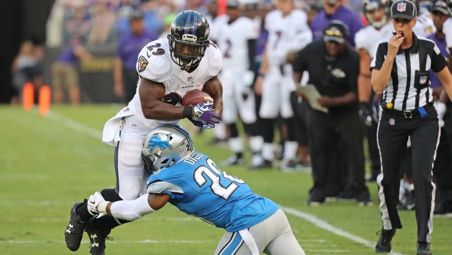 Baltimore Ravens running back Justin Forsett (29) is tackled after a run by Detroit Lions cornerback Quandre Diggs on Aug. 27, 2016.